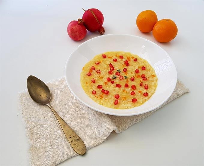 Risotto con arancia e melagrana